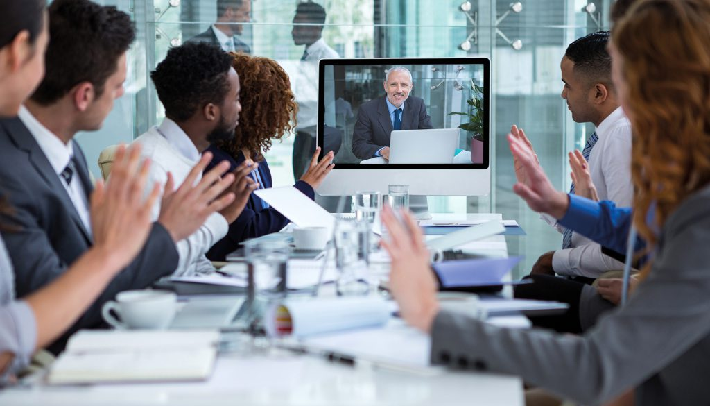 Business people looking at a screen during a video conference